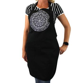 White Mandala on the front of a black cotton apron.