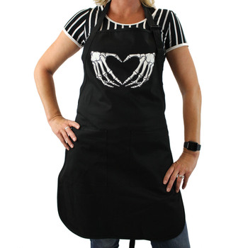 White skeleton hands shaped in a heart on the front of the black cotton apron.