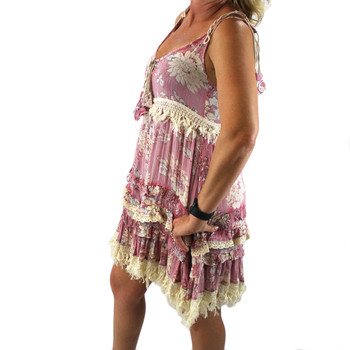 Boho style women's pink blossom print sundress side view.