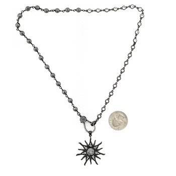 CZ sun pendant with 50/50 Hematite and CZ beaded necklace with quarter to show size.