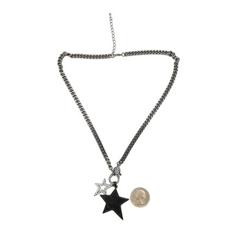 Hematite chain necklace with two CZ star pendants with quarter to show size.