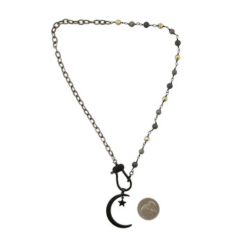 Moon and star bling necklace with quarter to show size.