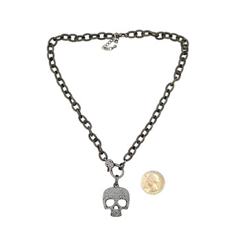 "Skull CZ Hematite bling necklace with 2"" extender and quarter to show the size of pendant."