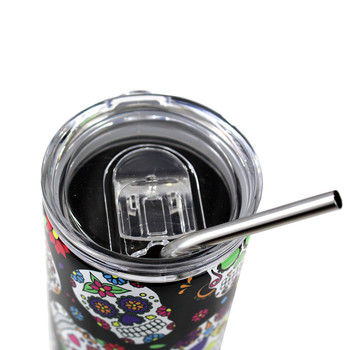 Top view of 20oz. colorful skulls stainless steel tumbler with metal straw.