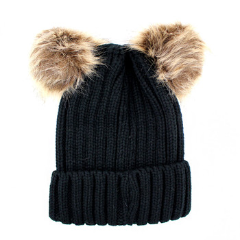 Winter black beanie hat with two pompoms.