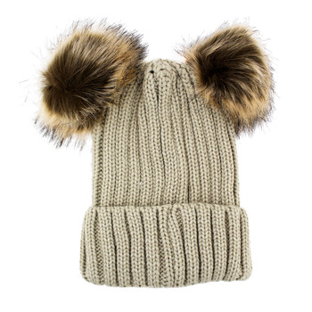 Winter beige beanie hat with two pompoms.