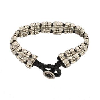 5 row silver alloy beaded bracelet on waxed linen.