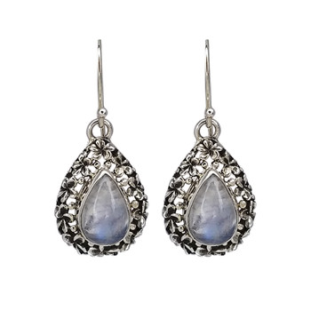 Sterling silver Moonstone dangle earrings with flower detail.