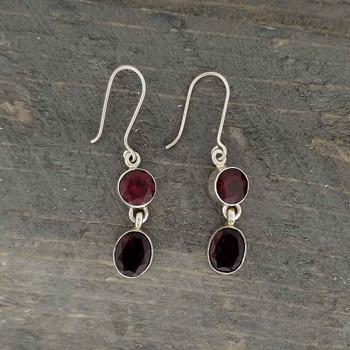 On wood Garnet sterling silver dangle earrings.