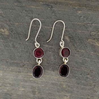 On wood Garnet sterling silver dangle earrings.