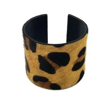 Tan leopard print cowhide cuff bracelet.
