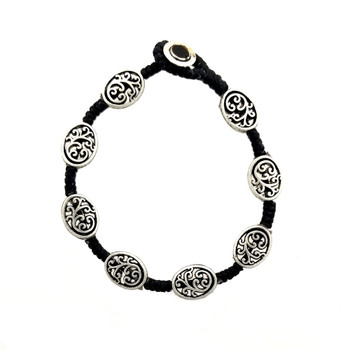 Floral swirl design alloy bracelet.