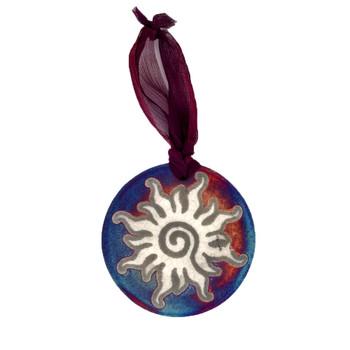 Sun Raku medallion ornament.
