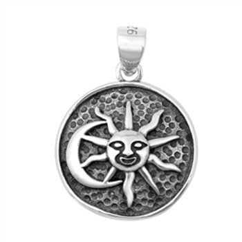 Sun and moon sterling silver pendant.