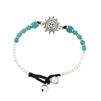 Silver alloy sun and turquoise howlite bracelet.