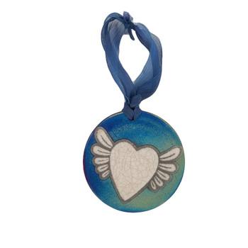 Winged heart medallion ornament.