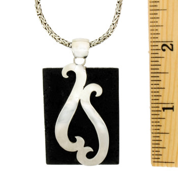 Lava Rock pendant with sterling silver design with ruler to show size.
