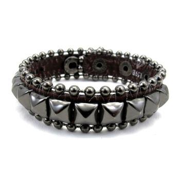 Brown studded leather bracelet.