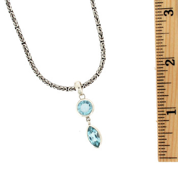 Blue Topaz sterling silver pendant with ruler.