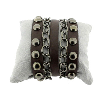 Brown leather cuff bracelet with studs and chains.