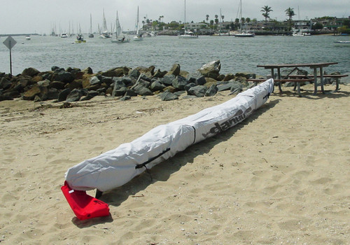Danuu Kahuna kayak cover with red warning flag bag at the back.