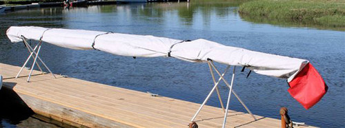 Danuu Monster kayak cover with red warning flag bag at the back.