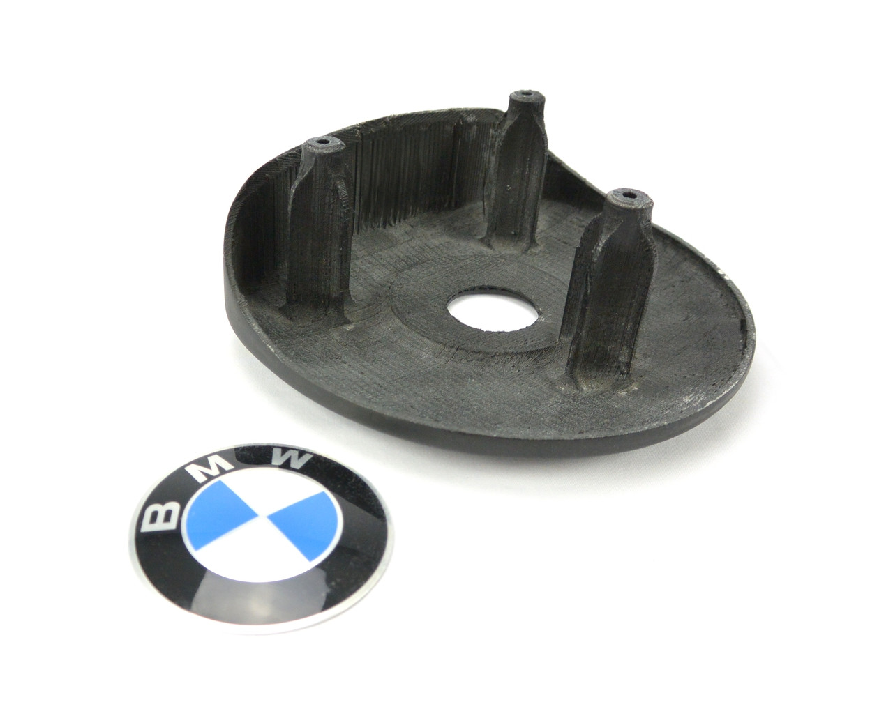 E9X Steering Wheel SRS Airbag Delete Panel. Fully incorporated stand-offs for factory mounting points on the E9X Airbag Delete for BMW