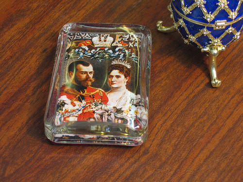 Nicholas and Alexandra Glass Paperweight on a desk