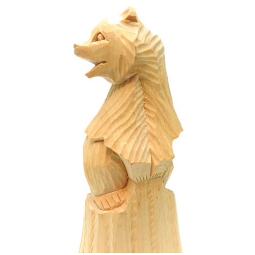 Bear Cub Clambering onto a Stump