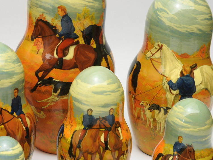 Closer look at a 20 piece set of Russian nesting matryoshka dolls with Borzois on the hunt