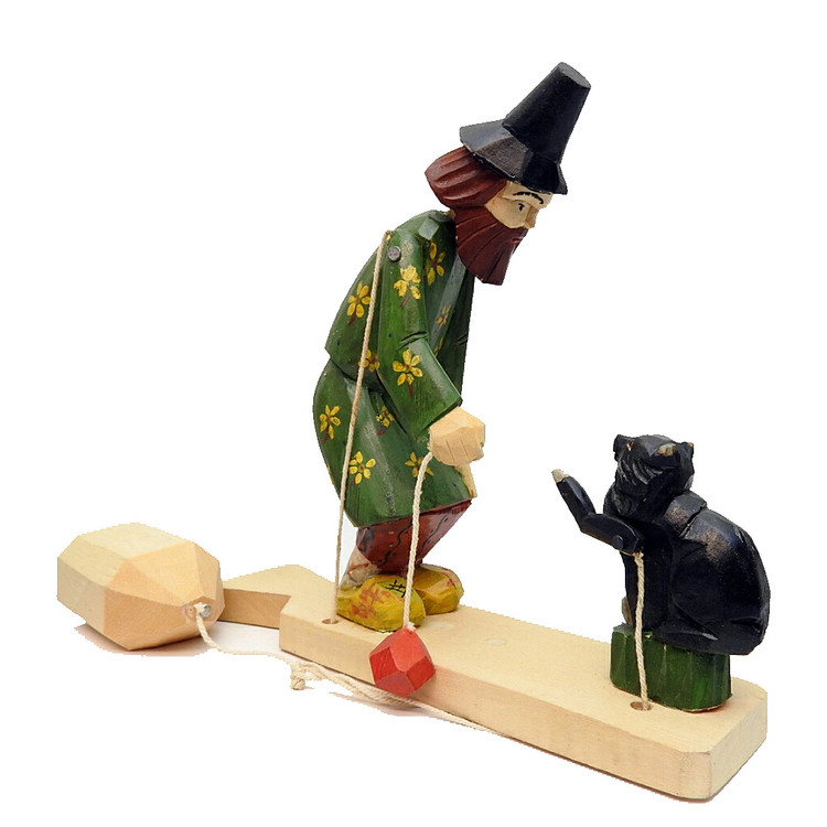 Bogorodsk Muzhik and Playful Black Cat