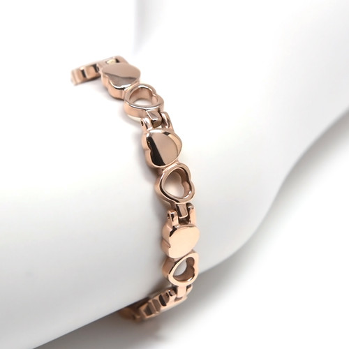"""<img src="""" womens  gold color magnet bracelet .png"""" alt=""""casual magnetic therapy jewelry  side view Magnetic  bracelet Jewelry Quad-Element Titanium Rose Gold  B185QM worn """">"""