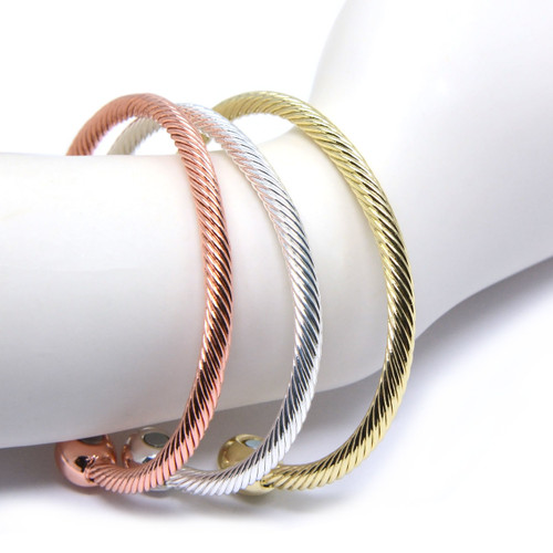 "<img src="" womens silver gold copper magnet bracelet .png"" alt=""casual magnetic therapy jewelry  strong  top view  "">"