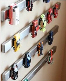 Magnetic strip holding child's toys