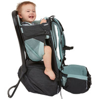 Thule Sapling Child Carrier Backpack with baby on board