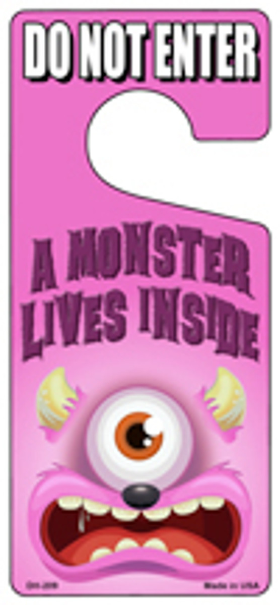 A Monster Lives Inside Pink Novelty Metal Door Hanger DH-209
