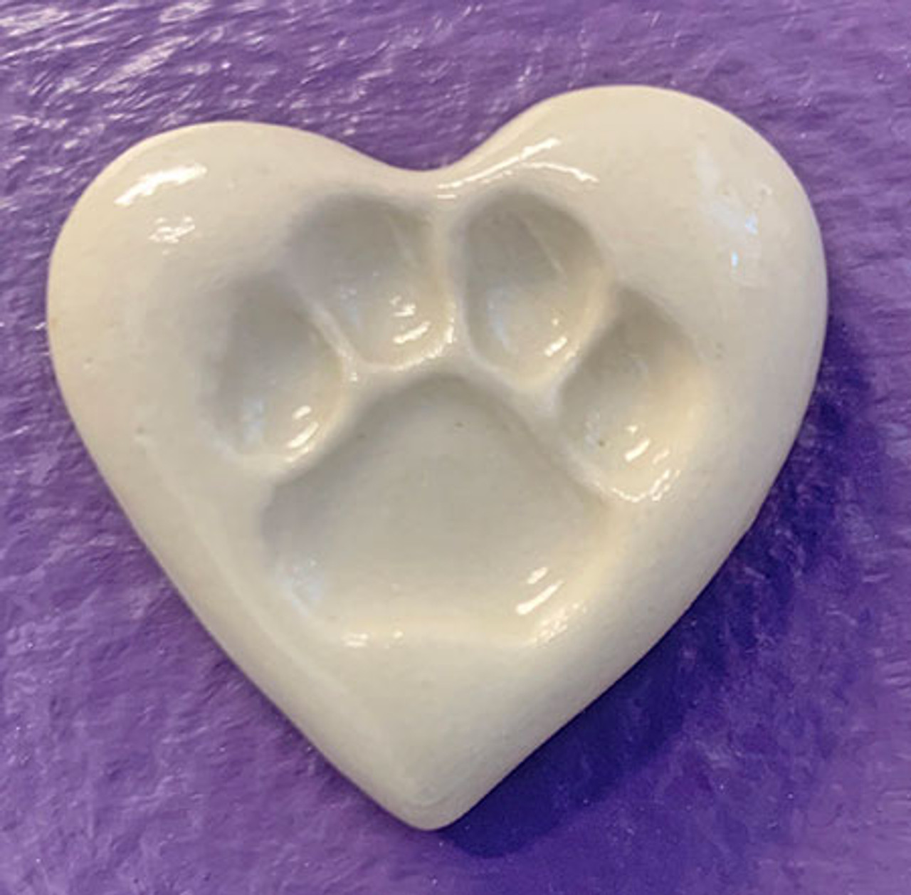 """VPPS - Pocket Paw Print Stones """"Photo courtesy of World by the Tail, Inc."""""""
