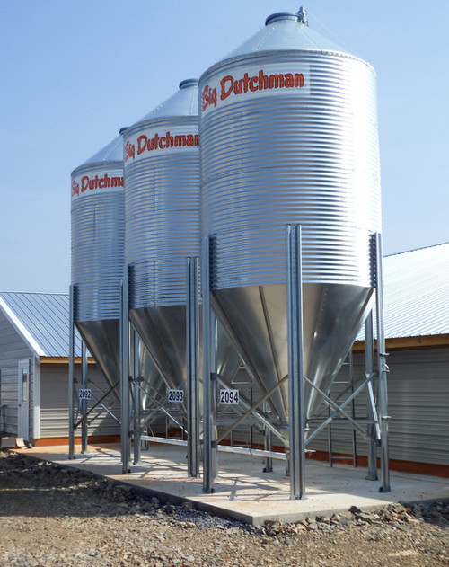 "Feed Bins For secure feed storage Big Dutchman feed hopper bins are designed to store flowable, noncorrosive material with 50 pound/cubic foot (800.9 kg/m3) bulk maximum density. The feed bins come in 3 standard sizes of 6, 9 and 12 feet in diameter. Each of the 3 sizes is available in 1 to 4 rings. The 12' bin is also available with 5 or 6 rings.  Important Advantages G115 galvanized coating provides a 28% greater protection and longer life than the market standard G90 bins Unique lid design opens 180°, keeping it out of the way of potential damage during filling Super engineering grade reflective tape at the peak opening allows for easy identification of the fill area at night Drip edge at bottom of sidewall sheets minimizes potential moisture down the hopper sheets and into the boot area The clearance under the outlet collar is 33.5"" – providing plenty of room for unloader accessories All bin wall sheets are of corrugated, galvanized steel with 2.66:"" (67.56mm) corrugation Crimp at room follows the contour of the sidewall sheet ensuring protection from the elements Ladder brackets have contours that match the corrugation of the sidewall sheets for maximum strength and safety A roof ladder from eave to the peak is standard Sealer strip is provided for all roof seams Safety cages for ladders are available for the 9′ and 12′ bins"