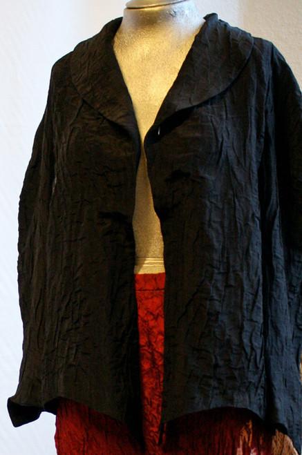 Blazer with raglan shoulders. Black double layered crinkled Silk. Front side.