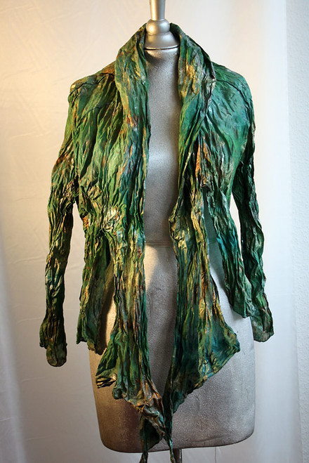 Raglan Bolero with attached scarf. Hemmed with Gold. Painted by in bronze, silver and Kelly green. Front side.