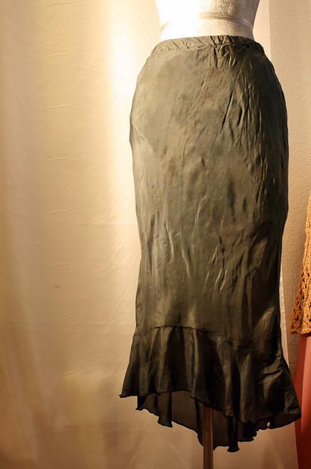 Fine feminine forest green bias cut skirt with asymmetrical ruffle.