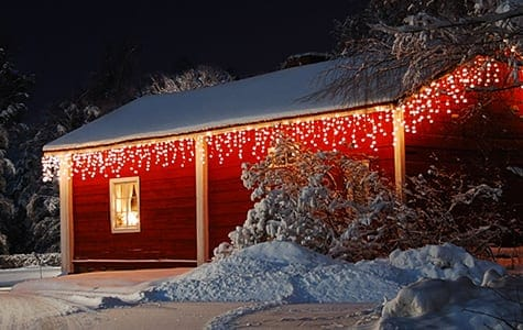 Clear Christmas Icicle Lights on Barn Roof