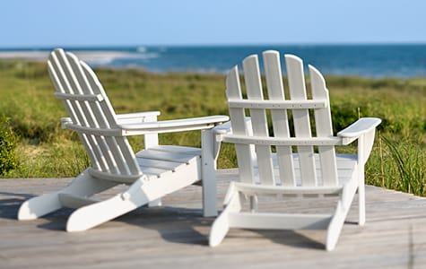 White Adirondack Chairs Looking at Ocean