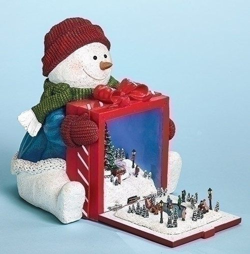 "8"" Red and White Pre-Lit Musical Snowman Holding Gift Rotating Train Christmas Tabletop Decor - IMAGE 1"
