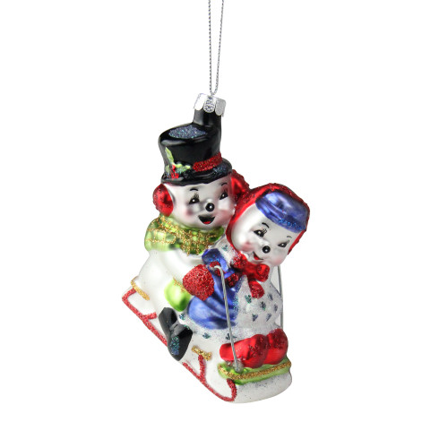 """4.5"""" White and Red Cheerful Sledding Snowmen Couple Glass Christmas Ornament - IMAGE 1"""