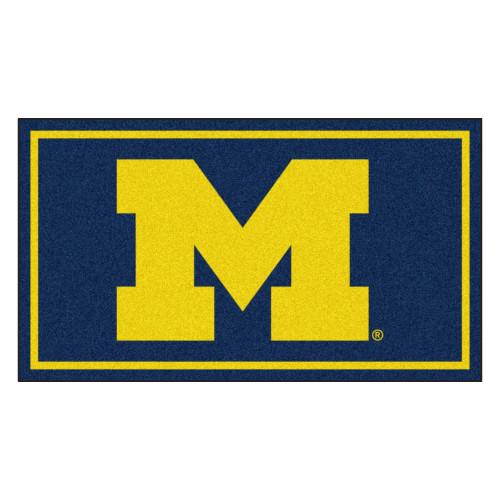 3' x 5' Blue and Yellow NCAA Michigan Wolverines Rectangular Plush Area Throw Rug - IMAGE 1