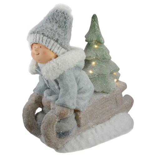 """15"""" Beige and Green Lighted Boy on a Sled Christmas Decoration - IMAGE 1"""