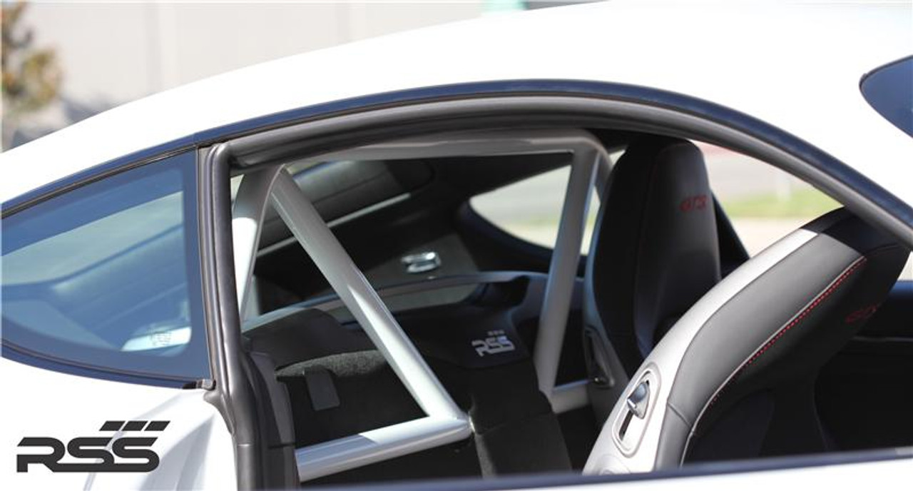 "The RSS ""951-Hybrid' Series 2pt Harness Bar (Uncoated - Raw) for 981 Cayman / GT4 / 718, is Engineered to maximize function, add rigidity, minimize added weight (+20 lbs), offer generous occupant seating space and integrate with interior. The Bar is a safety inspired design which secures safety harnesses directly behind the occupants shoulders. A one piece main hoop mounts to the chassis cross member and features a Straight Top Tube for a stronger main hoop. Diagonal Tubes provide additional structural support without obstructing the drivers rearward visibility. The Bar allows generous seat base travel with standard, OE bucket or racing bucket seats. Retains use of factory seat belts. Bolt-In installation, carpet, panel and tab trimming is required, Professional installation is recommended for a factory installed look. Designed, constructed and powder coated at RSS utilizing 1.50 inch DOM with precision cut reinforced mounting plates. Patent Pending Design"