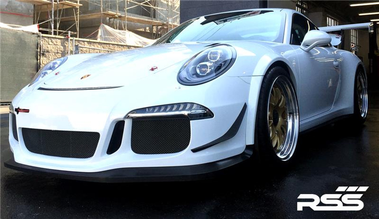 RSS - CarbonAero Kit # 241 for 991.1 GT3 and GT3 RS. Includes pair of FRONT CANARDS / DIVE PLANES, Aesthetically pleasing and aggressive in appearance, Canards have a functional purpose with direct benefits on street and motorsports applications. Designed with the latest CAD technology, constructed to exacting standards with pre-preg 2×2 Carbon Fibre Twill, finished in a high gloss clear coat with UV inhibitors, adhere with 3M VHB tape for easy application and removal, and are 100% Manufactured in USA. Components are are of the highest quality and are guaranteed to fit.• Produce down force by deflecting oncoming air upward resulting in a net down force on the front of the vehicle • Can direct air towards other important aero devices or cooling vents • Direct air away from the wheels and tires thereby reducing drag, turbulence and lift • Can be used to balance and tune front to rear down force levels