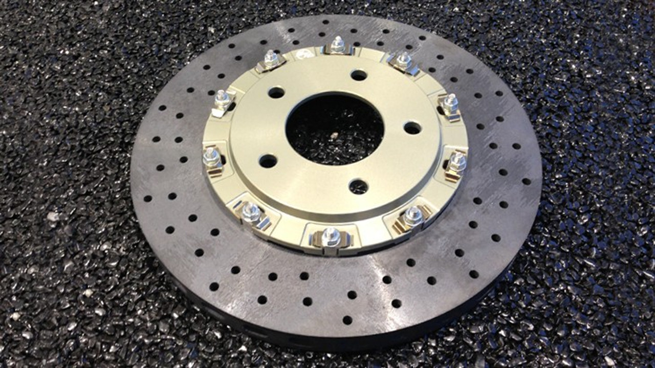 """CCST Carbon Ceramic  Brake Rotor Kit - 991 Turbo with Track Pads:  STK.10.374.386 - Kit Consists of:  - CCST Fully Assembled 2-Piece Rotor/Discs:  410mm x 36mm (F) x 2 + 400mm x 32mm (R) x 2  - Mouning Kit:Brake lines for larger diameter disc (OE Porsche parts)  - Track Pads Set Front and Rear  - Includes Free Shipping: In stock kits usually ship same day or within 48 hours.     RSS is proud to bring you the latest in Carbon Ceramic Brake Rotor Technology. CCST (Carbon Ceramic Surface Transform) Carbon Brake Discs are direct upgrade/replacement for Porsche PCCB and Porsche Steel Disc Brake Rotors.  CCST Carbon Ceramic Discs feature next generation """"Continuous Fiber Construction"""" - Patented Processvs Traditional Chopped Fiber Construction. Manufactured in the United Kingdom at ISO/TS16494 certified facilities and are strictly controlled to the highest standards.  CCST Discs are the choice of OEM Partners and Super Car / Hyper Car Manufactures such as: Aston Martin, Mono, Koenigsegg, Singer Vehicle Design in addition to several other OEM's who prefer anonymity. CCST rotors provide the ultimate in braking technology for motorsport such as the European Ferrari 458 Challenge, road-going hyper-cars and super-cars.  CCST Kits - Now Available for Porsche  •Porsche 981 Cayman GT4  •Porsche 991 GT3  •Porsche 991 GT3 RS  •Porsche 991 Turbo  •Porsche 991 Turbo S  •Porsche 991 Turbo  •Porsche 997 GT2  •Porsche 997 GT3  •Porsche 997 GT3 RS  •Porsche 997 Turbo  (993 Turbo Coming Soon!)  CCST - Carbon Ceramic Rotors vs. OEM – PCCB Carbon Ceramic Brakes & Current Generation Ceramic Rotors  PERFORMANCE + VALUE:  - Temperature Reductions of up to 150 Degrees Celsius/302 Degrees Fahrenheit  - Up to 3x thermal conductivity of current generation Carbon-Ceramic Matrix Discs (CCM)  - Weight Savings of up to 70% over Iron brakes  - 10x lifespan improvement vs current generation CCM Discs  - Better Vehicle Dynamics, improved handling and drivability  - Reduction in Noise, Vibration Harshness"""